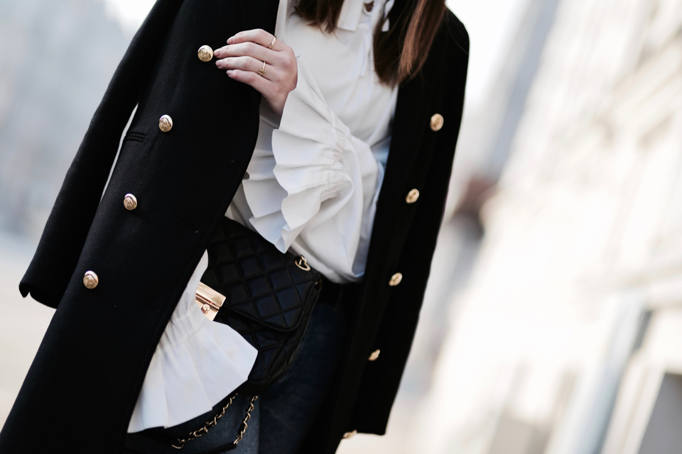 black coat with gold buttons outfit